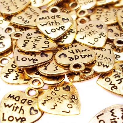 Charms oro 12x10 mm con scritta pacco da 10 pezzi.