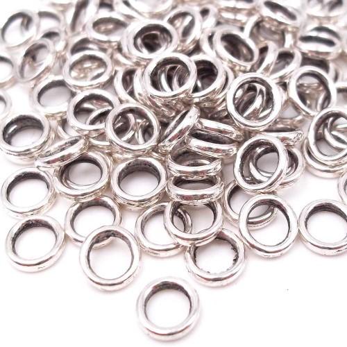 Distanziatori In Argento Tibetano | Distanziatore ad anellino 6 mm foro 4 mm pacco 50 pz - dr31