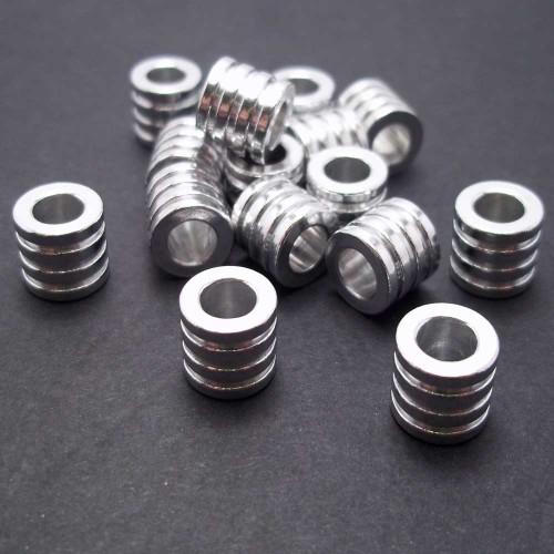 Componenti Alluminio | Distanziatore tubicino in alluminio 7x6x3.1 mm 2 pz - AL02